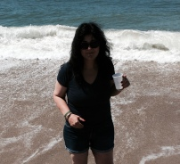 After: a happy day at the beach wearing my daughter's shorts...